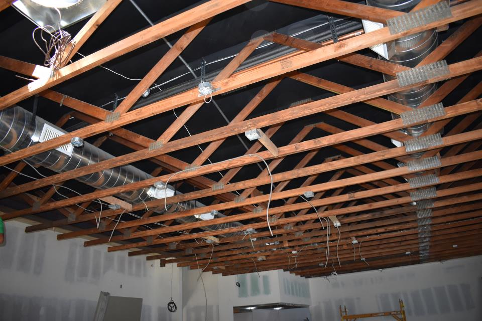 Future dining area that will feature an exposed ceiling with wooden beams.